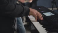 Guy playing on the concerto video