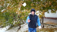 guy throws a snowball in the autumn park video