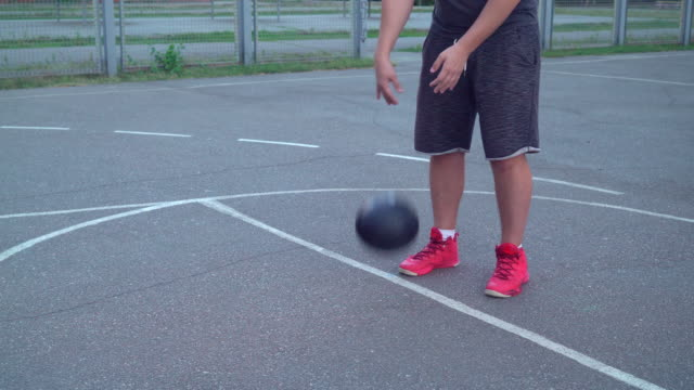 Guy training dribble at the sports ground video