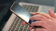 Guy typing message text on smartphone, fingers touching screen video
