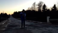 Guy well dances being on the road in the evening video