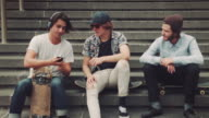 Guys hanging out in urban setting video