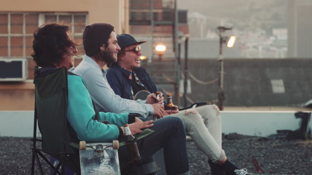 Guys hanging out on rooftop video