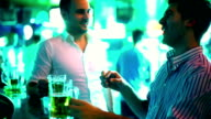 Guys having beer in a bar. video