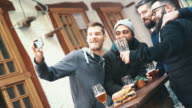 Guys taking selfies at a pub. video
