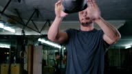 Gym man with dumbbells weights lifting exercise fitness workout, slow motion video