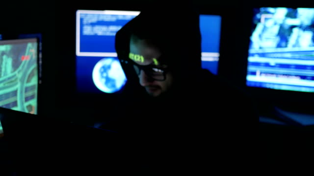 Hacker tries to enter the system using codes and numbers find out security password, hacker enters software to steal login information, IT professional video