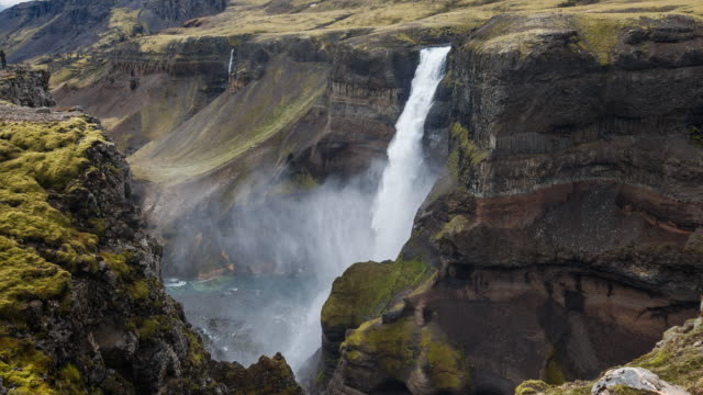 Haifoss waterfall dropping down into canyon in Iceland video