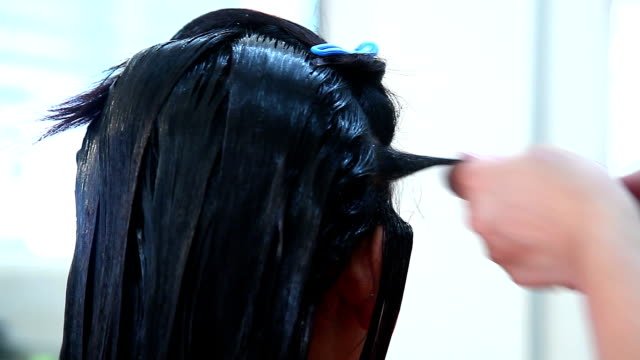 Hair Dresser Used Hair Straight on Woman's Head video