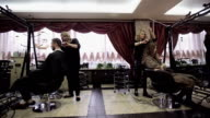 Hair salon working day. Slider camera movement video