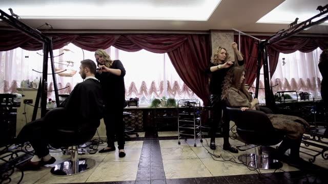 Hair salon working day. Slider camera movement video