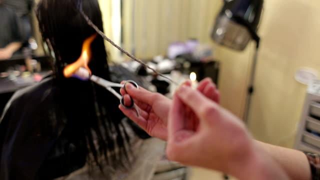 Haircut split ends of hair on fire. Haircut fire. video