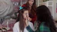 Hairdresser and visagiste artist working at model look. video