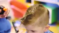 Hairdresser cutting cute childs hair video