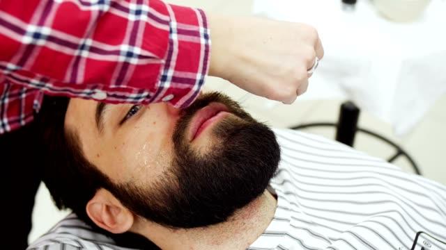 Hairdresser gets oil on beard video