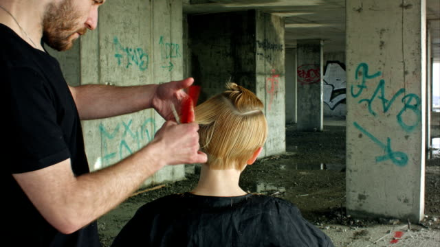 Hairdresser giving a new haircut video