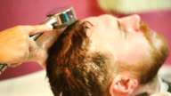 Hairdresser washes head client video