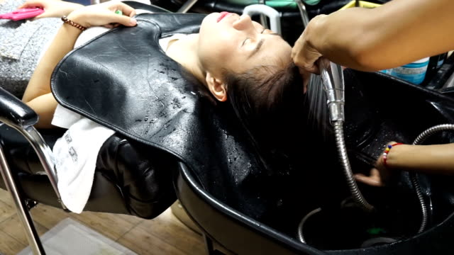 tight blue dress hairdresser takes care of her clients  143007