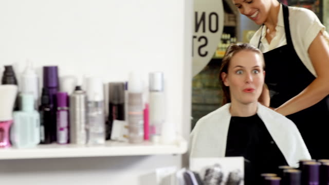 Hairdressers trimming their client hair video