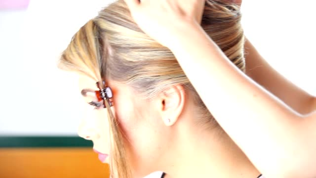 hairstyle, hairdresser's hands to work on client's hair at salon video