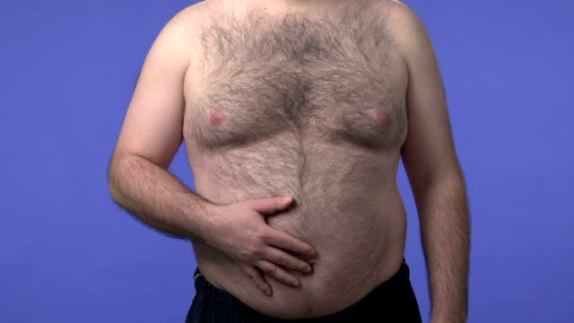 Hairy overweight man scratching his belly video