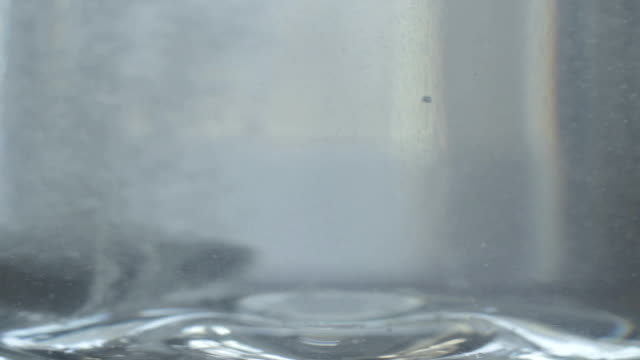 Half tablet dose dropped water glass, effervescent, health care video
