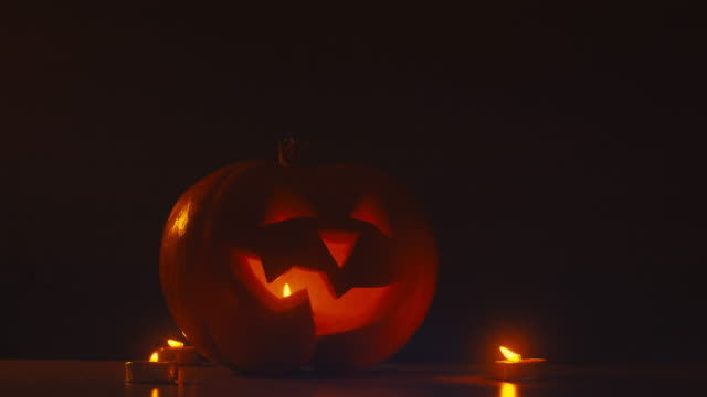 CINEMAGRAPH - CU Halloween carved pumpkin Jack-o-Lantern with candles video