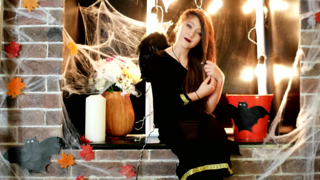 halloween celebration, young witch preraring to horror party, teen wearing costume, trick or treat video