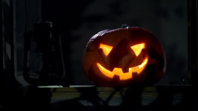Halloween clip - scary pumpkin and moving along the shadows. video