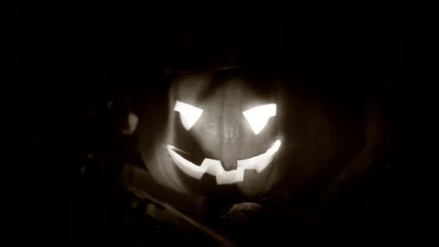 Halloween clip - scary pumpkin and shadows of the tress. video