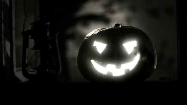 Halloween clip - scary pumpkin during a storm. video