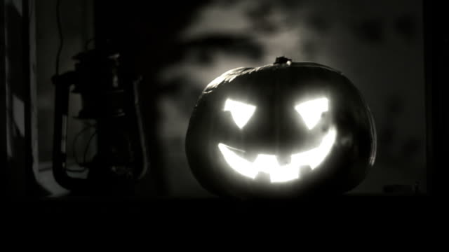 Halloween clip - scary pumpkin in the window. video