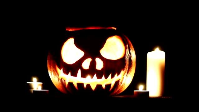halloween pumpkin, candle, light, curved, scary, jack-o-lantern, pumpkin head video