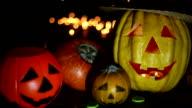 Halloween pumpkin head jack lantern on wooden background video