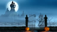 Halloween pumpkins next to a gate of a spooky castle video