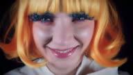 4K Halloween Shot of Doll Make-up Woman Eating Lollipop video