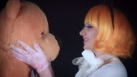 4K Halloween Shot of Doll Woman Playing with Teddy Bear video