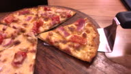 Ham and bacon with extra cheese pizza , Bangkok , Thialand video