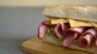Ham and salad submarine sandwich video