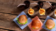 Hamburgers with fries and cola. video
