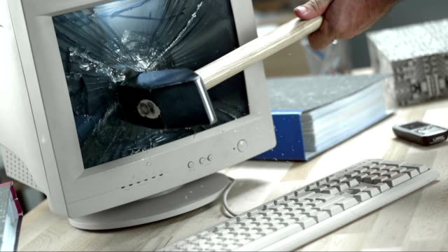 SLO MO Hammer breaking the computer screen video