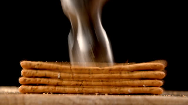 Hammer smashing biscuits on table video