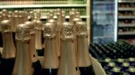 Сhampagne bottles wrapped in golden foil video