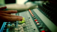 Hand adjusting audio mixer video