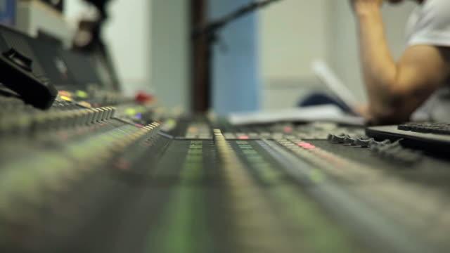 Hand Adjusting Audio Mixer video