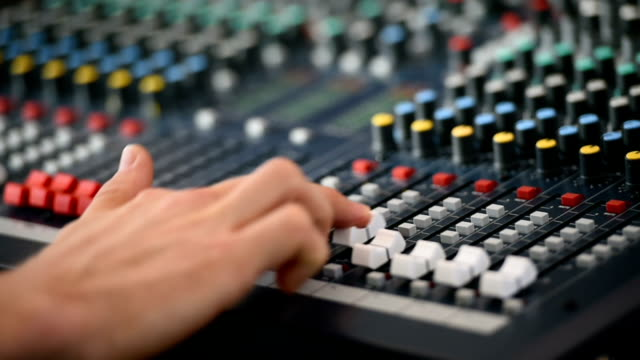 Hand adjusting professional audio mixer video