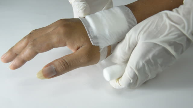 hand being bandaged video