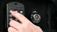 Hand dials number of apartment on intercom system video