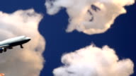 Hand flying a model airplane through clouds video