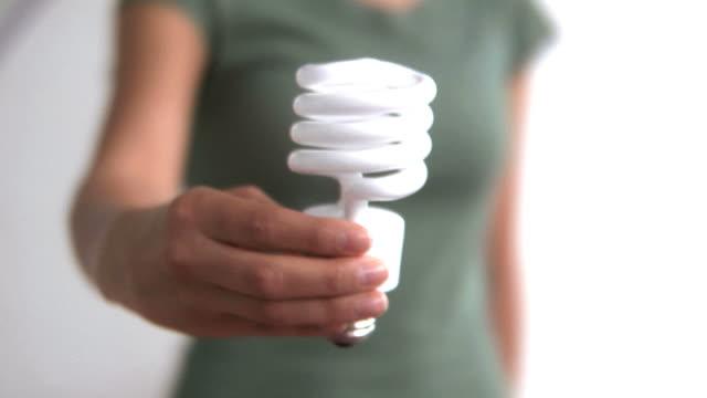 Hand holding energy efficient light bulb video